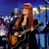 FILE - This April 4, 2011 file photo shows country singer Wynonna Judd from The Judds, performing at the Girls\' Night Out: Superstar Women of Country in Las Vegas. Judd is one of eleven celebrity contestants who will compete on the next edition of
