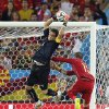 Photo - Chile's goalkeeper Claudio Bravo makes a save against Spain's Sergio Ramos during the group B World Cup soccer match between Spain and Chile at the Maracana Stadium in Rio de Janeiro, Brazil, Wednesday, June 18, 2014.  (AP Photo/Frank Augstein)