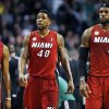 Miami Heat\'s Mario Chalmers (15), Udonis Haslem (40) and LeBron James (6) walk upcourt after a timeout in the first quarter of an NBA basketball game against the Boston Celtics in Boston, Monday, March 18, 2013. (AP Photo/Michael Dwyer)