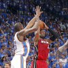 Oklahoma City\'s Kevin Durant (35) defends on Miami\'s Dwyane Wade (3) during Game 1 of the NBA Finals between the Oklahoma City Thunder and the Miami Heat at Chesapeake Energy Arena in Oklahoma City, Tuesday, June 12, 2012. Photo by Chris Landsberger, The Oklahoman