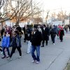 Photo - People march down Washington Street towards Greater Norris Chapel Baptist Church during the Henderson County Black History Committee's Celebration of Dr. Martin Luther King, Jr's birthday in Henderson, Ky. Sunday Jan. 19, 2014. (AP Photo/The Gleaner, Darrin Phegley)