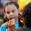 Gabrielle Gallegos, 8, gets help with her costume from her grandmother, June Carpitcher of Oklahoma City. Gabrielle is a member of the Seminole Nation, but for the pow-wow, she dressed in Ponca attire to perform in the southern cloth dances. At least 500 people representing several dozen Native American Nations within the state attended a New Year\'s pow-wow in the Centennial Building at State Fair Park Saturday , January 7, 2012, The celebration started around shortly after noon and continued into the night. Several hundred took part in the various dancers and the dancers wore tribal regalia. Photo by Jim Beckel, The Oklahoman