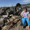 Stella Howard sits as family and friends help sort through her home in the Plaza Towers neighborhood in Moore, Okla., on Wednesday, May 22, 2013. Stella and her husband Howard took shelter in a bath tub as a tornado struck their home on Monday, May 20, 2013. The couple also had their home destroyed by the May 3, 1999 tornado in Midwest City. Photo by Bryan Terry, The Oklahoman