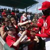 Photo - Cincinnati Reds' Brandon Phillips signs autographs before an exhibition baseball game against the Cleveland Indians in Goodyear, Ariz., Thursday, Feb. 27, 2014. (AP Photo/Paul Sancya)