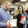 Photo -      Instructor Benton Shriver scores Samantha Flores, a senior, and her team's digestive system project in their anatomy and physiology class at Putnam City High School. Photo by Paul B. Southerland, The Oklahoman   PAUL B. SOUTHERLAND -