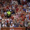 Photo - St. Louis Cardinals' Yadier Molina, left, gets a standing ovation in the first inning of a baseball game against the Chicago Cubs, Friday, Aug. 29, 2014, at Busch Stadium in St. Louis. This is Molina's first game after seven weeks on the disabled list with a right thumb injury. (AP Photo/Bill Boyce)