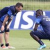 Photo - Italy's Antonio Cassano, left, talks with teammate Mario Balotelli during a training session in Mangaratiba, Brazil, Wednesday, June 11, 2014. Italy will play in group D of the Brazil 2014 soccer World Cup. (AP Photo/Antonio Calanni)
