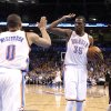 Oklahoma City\'s Russell Westbrook (0) and Kevin Durant (35) celebrate a dunk in front of Sacramento\'s Jimmer Fredette (7) during the NBA basketball game between the Oklahoma City Thunder and the Sacramento Kings at Chesapeake Energy Arena in Oklahoma City, Tuesday, April 24, 2012. Photo by Sarah Phipps, The Oklahoman.