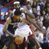 Miami Heat\'s LeBron James (6) blocks Charlotte Bobcats\' Chris Douglas-Robert (55) during the second half of an NBA basketball game in Miami, Monday, March 3, 2014. LeBron James scored a team recond of 61 points. The Heat won 124-107. (AP Photo/J Pat Carter)