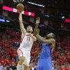 Houston\'s Carlos Delfino (10) goes past Oklahoma City\'s Kevin Durant (35) for a dunk during Game 4 in the first round of the NBA playoffs between the Oklahoma City Thunder and the Houston Rockets at the Toyota Center in Houston, Texas,Sunday, April 29, 2013. Oklahoma City lost 105-103. Photo by Bryan Terry, The Oklahoman