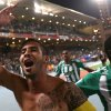Photo - Raja Casablanca's captain Mohsine Moutaouali celebrates after winning the semi final soccer match between Raja Casablanca and Atletico Mineiro at the Club World Cup soccer tournament in Marrakech, Morocco, Wednesday, Dec. 18, 2013. (AP Photo/Matthias Schrader)
