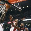 Photo - Portland Trail Blazers' Thomas Robinson (41) goes to the net against Toronto Raptors Terrence Ross during an NBA basketball game in Toronto on Sunday, Nov. 17, 2013. (AP Photo/The Canadian Press, Aaron Vincent Elkaim)