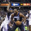 Charlotte Bobcats center Al Jefferson (25) drives to the basket against Sacramento Kings center DeMarcus Cousins during the first half of an NBA basketball game in Sacramento, Calif., on Saturday, Jan. 4, 2014. (AP Photo/Steve Yeater)
