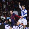 FC Barcelona\'s Lionel Messi, from Argentina, left, duels for the ball against Real Sociedad\'s Ion Ansotegi during a Copa del Rey soccer match at the Camp Nou stadium in Barcelona, Spain, Wednesday, Feb. 5, 2014. (AP Photo/Manu Fernandez)