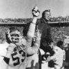 OU COLLEGE FOOTBALL: Victorious Oklahoma coach Barry Switzer is carried off the field as the clock runs out on time for Nebraska in 1980. Staff photo by Paul B. Southerland.