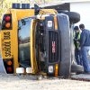 Emergency workers investigate an accident Tuesday involving a school bus and an automobile at the intersection of NW 89 and Classen Boulevard in Oklahoma City. photo BY PAUL HELLSTERN, THE OKLAHOMAN