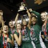Courtney Walker (23) raises the gold ball championship trophy as the Edmond Santa Fe Lady Wolves celebrate after the Class 6A girls high school basketball state tournament championship game between Edmond Santa Fe and Edmond Memorial at the Mabee Center in Tulsa, Okla., Saturday, March 10, 2012. Santa Fe won, 44-41. Photo by Nate Billings, The Oklahoman
