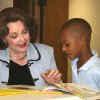 """Pi Phi Betty Crow reads """"I Wanna Iguana"""" by Karen Kaufman Orloff to 8-year-old Isaiah Bostic, a participant in Evangelistic Baptist Church's Back to Basics after school program. Community Photo By: Mary Ann Osko Submitted By: Mary Ann, oklahoma city"""