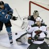 Photo - Minnesota Wild goalie Darcy Kuemper, center, stops a shot attempt from San Jose Sharks' Joe Pavelski (8) during the first period of an NHL hockey game on Saturday, Jan. 25, 2014, in San Jose, Calif. (AP Photo/Marcio Jose Sanchez)