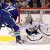 Nashville Predators\' Pekka Rinne, right, of Finland, stops Vancouver Canucks\' Ryan Kesler during the first period of an NHL hockey game in Vancouver, British Columbia, on Wednesday, Jan. 26, 2011. (AP Photo/The Canadian Press, Darryl Dyck)
