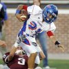 Sam Kreutzer (3) of Edmond Memorial tries to stop Ryan Lujan (21) of Moore on a carry during a high school football game between Edmond Memorial and Moore at Wantland Stadium in Edmond, Okla., Thursday, Sept. 29, 2011. Photo by Nate Billings, The Oklahoman