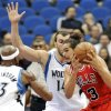 Chicago Bulls\' Joakim Noah, right, looks for assistance as he is pressured by Minnesota Timberwolves\' Dante Cunningham, left, and Nikola Pekovic, center, of Montenegro, in the first half of an NBA preseason basketball game, Saturday, Oct. 13, 2012, in Minneapolis. (AP Photo/Jim Mone)