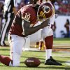 Photo -   Washington Redskins quarterback Robert Griffin III (10) reacts after scoring on a five-yard touchdown run against the Tampa Bay Buccaneers during the second quarter of an NFL football game Sunday, Sept. 30, 2012, in Tampa, Fla. (AP Photo/Margaret Bowles)