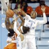 North Carolina\'s Stephanie Mavunga (1) and Jessica Washington (24) defend against Clemson\'s Nikki Dixon (21) during the first half of an NCAA college basketball game in Chapel Hill, N.C., Thursday, Jan. 16, 2014. (AP Photo/Gerry Broome)
