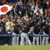 Photo -   FILEL - In this March 23, 2009 file photo, Japan celebrates on the field after beating South Korea 5-3, in the final of the World Baseball Classic in Los Angeles. The Japanese players' association agreed to take part in the 2013 World Baseball Classic Tuesday, Sept. 4, 2012, backing off from a threat to boycott the event over the way tournament revenue is shared. (AP Photo/Mark J. Terrill, File)