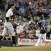 Colorado Rockies starting pitcher Christian Friedrich walks back to the mound after giving up a two-run home run to Milwaukee Brewers\' Aramis Ramirez during the first inning of a baseball game Thursday, June 26, 2014, in Milwaukee. (AP Photo/Morry Gash)