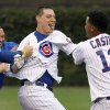 Chicago Cubs\' Starlin Castro, right, and teammates mob Bryan LaHair after LaHair hit the game-winning single off Houston Astros relief pitcher Hector Ambriz during the ninth inning of a baseball game Wednesday, Oct. 3, 2012, in Chicago. The Cubs won 5-4. (AP Photo/Charles Rex Arbogast)