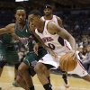 Atlanta Hawks\' Jeff Teague (0) drives against Milwaukee Bucks\' Brandon Jennings, left, during the first half of an NBA basketball game, Saturday, Feb. 23, 2013, in Milwaukee. (AP Photo/Jeffrey Phelps)