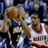 Portland Trail Blazers forward LaMarcus Aldridge, right, defends Indiana Pacers forward David West during the first quarter of an NBA basketball game in Portland, Ore., Wednesday, Jan. 23, 2013. (AP Photo/Don Ryan)