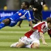 Montreal Impact\'s Sanna Nyassi falls over Toronto FC\'s Torsten Frings during the second half of an Amway Canadian Championship soccer match, Wednesday, May 2, 2012, in Montreal. (AP Photo/The Canadian Press, Paul Chiasson)