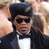 Brazilian songwriter Carlinhos Brown arrives before the 84th Academy Awards on Sunday, Feb. 26, 2012, in the Hollywood section of Los Angeles. (AP Photo/Joel Ryan) ORG XMIT: OSC398