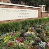 Flowers grow in front of a sign at the Chesapeake campus in Oklahoma City. AP Archives Photo