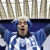 A fan from Honduras cheers before the group E World Cup soccer match between France and Honduras at the Estadio Beira-Rio in Porto Alegre, Brazil, Sunday, June 15, 2014. (AP Photo/Martin Meissner)