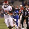 Oklahoma\'s Trent Ratterree (47) fights of Kansas\' Greg Brown (5) during the college football game between the University of Oklahoma Sooners (OU) and the University of Kansas Jayhawks (KU) at Memorial Stadium in Lawrence, Kansas, Saturday, Oct. 15, 2011. Photo by Bryan Terry, The Oklahoman