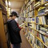 Left: Zach Olson, 13, a student at Summit Middle School in Edmond, looks through books at the Aladdin Book Shoppe in the Mayfair Village shopping center at NW 50 and N May Avenue.