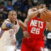 Oklahoma CIty\'s Russell Westbrook goes for the ball beside New Jersey\'s Stephen Graham during the NBA basketball game between the Oklahoma City Thunder and the New Jersey Nets at the Oklahoma City Arena, Wednesday, Dec. 29, 2010. Photo by Bryan Terry, The Oklahoman ORG XMIT: KOD