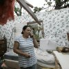 Yolanda Suarez talks on her cell phone in what is left of the bedroom of her mobile home in Seminole, Okla., Tuesday, May 11, 2010. Several tornadoes swept through Oklahoma on Monday, leaving a path of destruction, including Suarez\'s home. (AP Photo/Sue Ogrocki) ORG XMIT: OKSO102