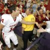 OU quarterback Sam Bradford (14) slaps hands with OU fans after the college football game between Oklahoma and Washington at Husky Stadium in Seattle, Wash., Saturday, September 13, 2008. OU beat UW, 55-14. BY NATE BILLINGS, THE OKLAHOMAN
