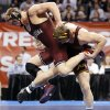 OU\'s Andrew Howe, left, wrestles Minnesota\'s Logan Storley in a 174-pound semifinal during the 2014 NCAA Div. I Wrestling Championships at Chesapeake Energy Arena in Oklahoma City, Friday, March 21, 2014. Howe won and advanced to the championship. Photo by Nate Billings, The Oklahoman