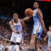 Oklahoma City\'s Russell Westbrook (0) passes the ball past Denver\'s Arron Afflalo (6) during the NBA basketball game between the Oklahoma City Thunder and the Denver Nuggets at Chesapeake Energy Arena in Oklahoma City, Wednesday, April 25, 2012. Photo by Bryan Terry, The Oklahoman