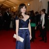 """Zooey Deschanel attends The Metropolitan Museum of Art\'s Costume Institute benefit gala celebrating """"Charles James: Beyond Fashion"""" on Monday, May 5, 2014, in New York. (Photo by Evan Agostini/Invision/AP)"""