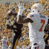 Missouri\'s E.J. Gaines (31) intercepts a pass intended for Oklahoma State\'s Michael Harrison (7) in the end zone during the third quarter of a college football game between the Oklahoma State University Cowboys (OSU) and the University of Missouri Tigers (Mizzou) at Faurot Field in Columbia, Mo., OSU won, 45-24. Saturday, Oct. 22, 2011. Photo by Nate Billings, The Oklahoman