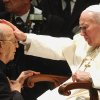 FILE - In this Nov. 30, 2004 file photo, Pope John Paul II gives his blessing to father Marcial Maciel, founder of the Legion of Christ, during a special audience at the Vatican. Pope Benedict XVI took over the Legion in 2010 after a Vatican investigation determined that Maciel had sexually molested seminarians and fathered three children by two women. Following a decision Thursday Feb. 14, 2013, by the Rhode Island Supreme Court, documents are set to be unsealed related to a lawsuit contesting the will of Gabrielle Mee, who left $60 million to the Legion. (AP Photo/Plinio Lepri, File)