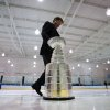 Mike Bolt, keeper of the Stanley Cup, takes it off the ice after members of the Vancouver Angels novice C1 minor hockey team were surprised with it before their youth practice Friday, Dec. 7, 2012, in Vancouver, British Columbia. Five minor hockey teams in Canada were randomly chosen to receive a surprise appearance by the Stanley Cup as part of the Scotiabank Community Hockey Sponsorship Program. The NHL lockout is in its 82nd day. (AP Photo/The Canadian Press, Darryl Dyck)