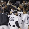 New York Yankees\' Raul Ibanez celebrates with teammates as he reaches home plate after hitting the game-winning home run during the 12th inning of Game 3 of the American League division baseball series against the Baltimore Orioles on Wednesday, Oct. 10, 2012, in New York. The Yankees 3-2. (AP Photo/Kathy Willens)