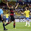 Photo - Germany's Sami Khedira celebrates after scoring his side's fifth goal during the World Cup semifinal soccer match between Brazil and Germany at the Mineirao Stadium in Belo Horizonte, Brazil, Tuesday, July 8, 2014. (AP Photo/Natacha Pisarenko)